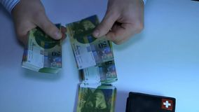 Unknown businessman counting money. Swiss frank. HD stock video footage
