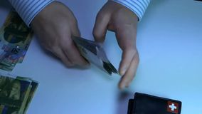 Unknown businessman counting money. Swiss frank. stock video footage