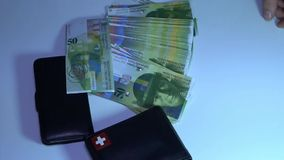 Unknown businessman counting money. Swiss frank. HD stock footage