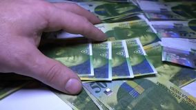Unknown businessman counting money. Swiss frank. stock footage