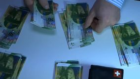 Unknown businessman counting money. Swiss frank. stock video