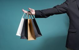 Bargain sale concept. Unknown businessman hold the shopping paper bag , bargain sale concept royalty free stock photography