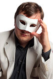 Unknown businessman wearing carnival mask Stock Images