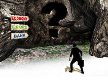 Unknown economy. A businessman looking for economy, faces a dark cave, the entrance of which is a big question mark Royalty Free Stock Photos