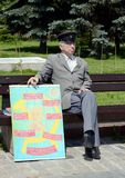 An unknown elderly man with a Communist poster on the Poklonnaya Hill of Moscow. Stock Images