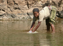 An unknown Ethiopian woman washes in the river in Roby, Ethiopia - November 23, 2008. Royalty Free Stock Images
