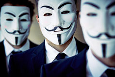 Unknown faces. Close-up of unknown people wearing anonymous masks Royalty Free Stock Photo