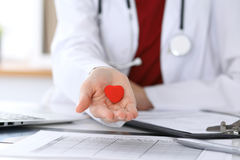 Unknown female doctor with stethoscope holding heart. Children`s cardiology and medical care, stop abortation concept stock image