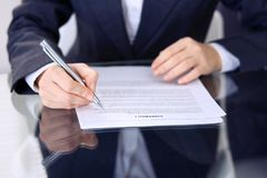 Unknown female hands with pen over document of contract. Agreement signing or business concept.  royalty free stock images