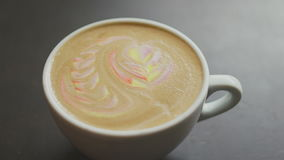 Unknown flips mug with colorful rainbow latte stock video footage