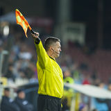 Unknown football referee performs during the soccer game Royalty Free Stock Images