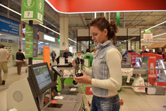 Unknown girl at the checkout self. Petersburg, Russia Royalty Free Stock Photo