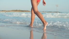 Free Unknown Girl Enjoying Summer At Beach. Slim Woman Legs Walking At Coastline. Stock Photo - 214311340