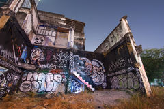 Unknown graffiti artist painting on Abandoned building wall stock photos