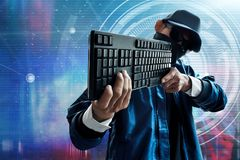 Unknown hacker hold keyboard to aim target Royalty Free Stock Photo