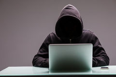 Free Unknown Hackers Programmer Using Computer Laptop For Hack Inform Stock Photography - 96585012
