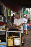 A unknown hawker prepares stay on the street in Ipoh, Malaysia Stock Photography