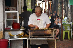 A unknown hawker prepares stay on the street in Ipoh, Malaysia Royalty Free Stock Photos