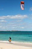Unknown kitesurfer surfing on a flat azure water of Atlantic ocean in Corralejo, Fuerteventura Royalty Free Stock Images