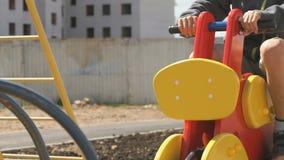 Little boy ride horse - swing outdoors stock footage