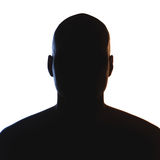 Unknown male person silhouette. Back lit studio isolated Royalty Free Stock Photos