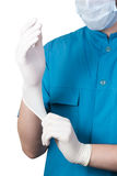 Unknown male surgeon doctor clothing glove on the hand isolated on white. Unknown male surgeon doctor clothing white glove on the hand isolated on white Stock Photos
