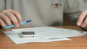 Man reads document text on paper. Close-up stock footage