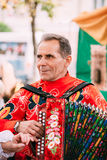 Unknown man in national clothes plays the accordion folk Belarus Royalty Free Stock Photos