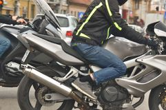 Motorcycle Rider. Unknown man riding a motorcycle in the city Stock Photo