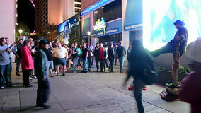 Unknown man seating on pylone on Las Vegas Strip, stock footage