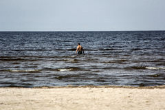 Unknown man swimming in the sea Royalty Free Stock Photography