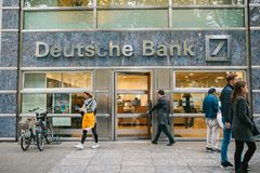 Berlin, October 2, 2017: Unknown man walks into the beautiful glass office of Deutsche Bank stock photo