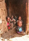 Unknown Masai village near Amboselli park, Kenya - April 02, 2015: Group of poor dirty children with faces and mouth covered with stock images