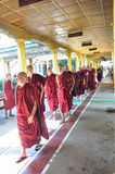 Unknown monks walking at the temple of Shwethalyaung Reclining B Stock Photo
