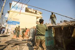 Unknown nepalese police during a operation on demolition of residential slums. Stock Image