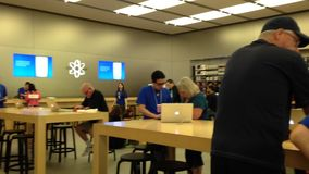 Unknown people in Apple store on Coquitlam Center Mall stock video footage