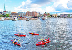 Unknown people are boating in kayaks in Stockholm Stock Images