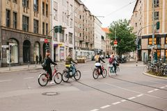 Berlin, October 2, 2017: Unknown people cross the street on bicycles Stock Photos