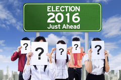 Unknown people with election board Stock Image