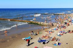 ZELENOGRADSK, KALININGRAD REGION, RUSSIA - JULY 29, 2017: Unknown people resting on a sandy beach on the Baltic Sea coast. stock image