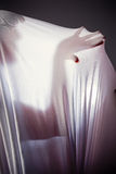 Unknown people  with a slender figure and growing fabric, shadow. Unknown people  with a slender figure and growing fabric Stock Images
