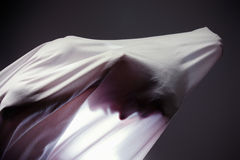 Unknown people  with a slender figure and growing fabric, shadow. Unknown people  with a slender figure and growing fabric Royalty Free Stock Photos