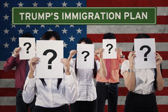 Unknown people with USA flag and Trump`s plan Royalty Free Stock Photo