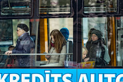 Unknown people via public transport window. Royalty Free Stock Images