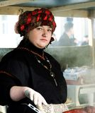 Unknown person in traditional flea market cooking in street kitchen on Feb 7, 2016 in Vilnius, Lithuania Royalty Free Stock Photography