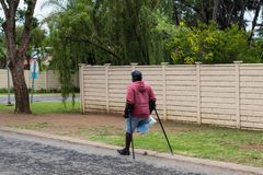 Unknown physically disabled man on crutches. Johannesburg, South Africa - unknown physically disabled man struggles on his crutches in a street in the city Royalty Free Stock Photos