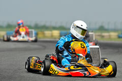 Unknown pilots competing in National Karting Championship. BUCHAREST, ROMANIA -MAY 17: Unknown pilots competing in National Karting Championship 2015 at Amkart Stock Photography