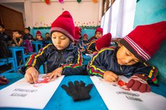 Unknown pupils in English class at primary school, Dec 24, 2013 in Kathmandu, Nepal. Stock Photo