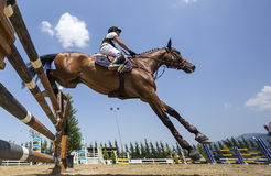 Unknown rider on a horse during competition matches riding round Royalty Free Stock Image