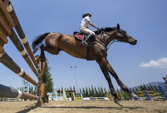 Unknown rider on a horse during competition matches riding round Stock Image